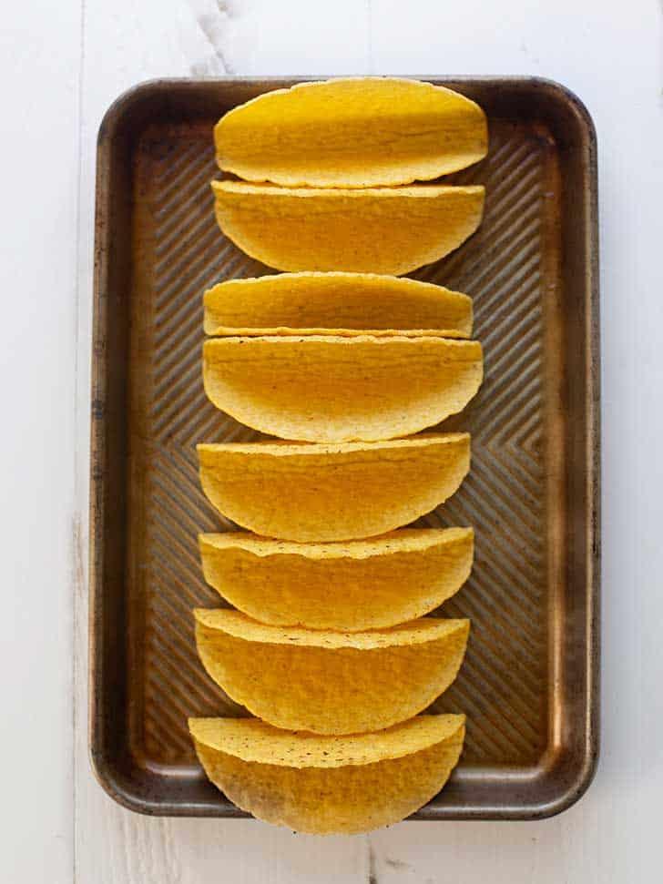 taco shells on a baking sheet