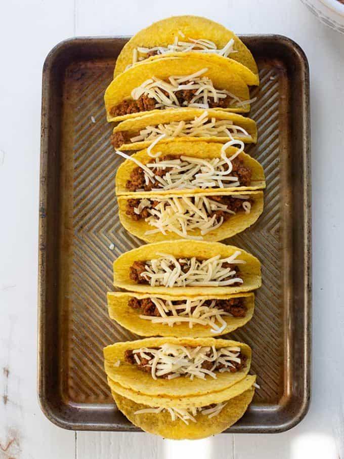 hard shell tacos on a sheet pan