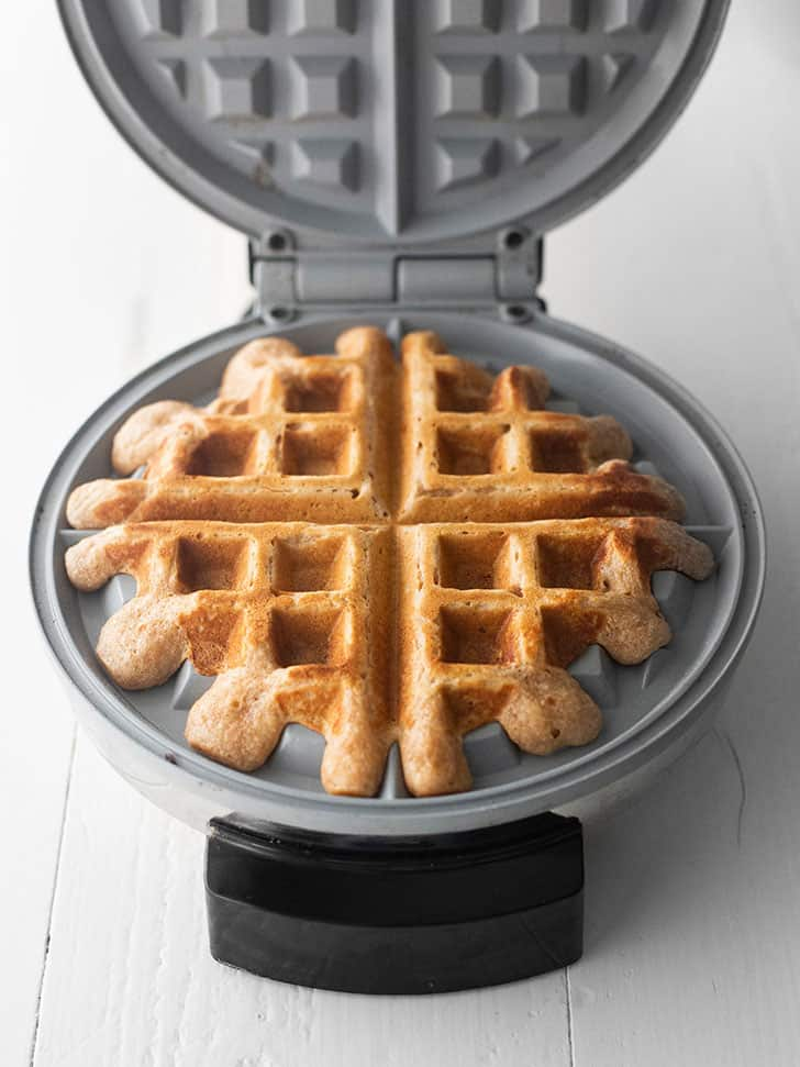 overnight yeasted whole wheat waffles in a waffle maker