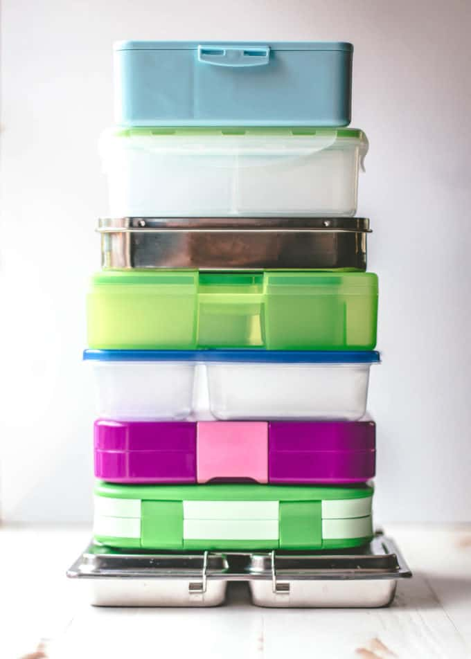 a stack of lunchboxes on a white table