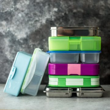 lunchboxes stacked on a table