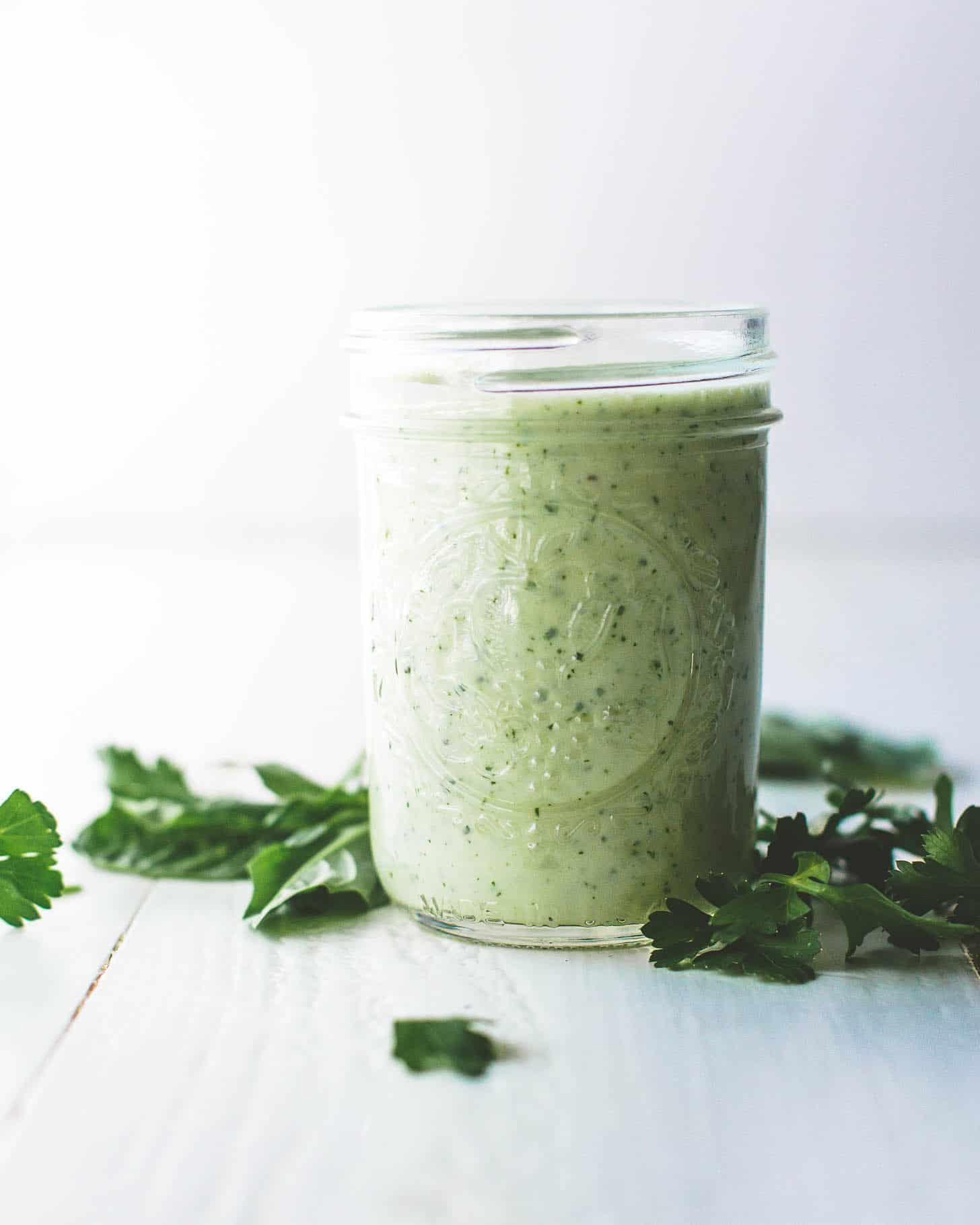 Yogurt Herb Dressing in a small mason jar