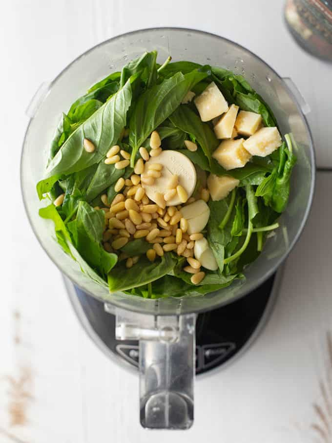 basil, parmesan and pine nuts in a food processor