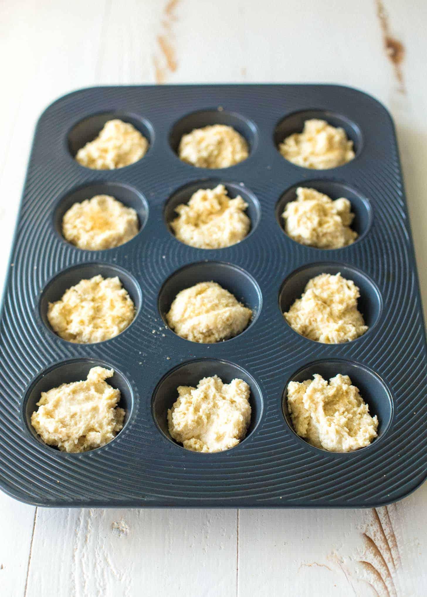 Muffin Pan Strawberry Shortcake batter in a muffin pan