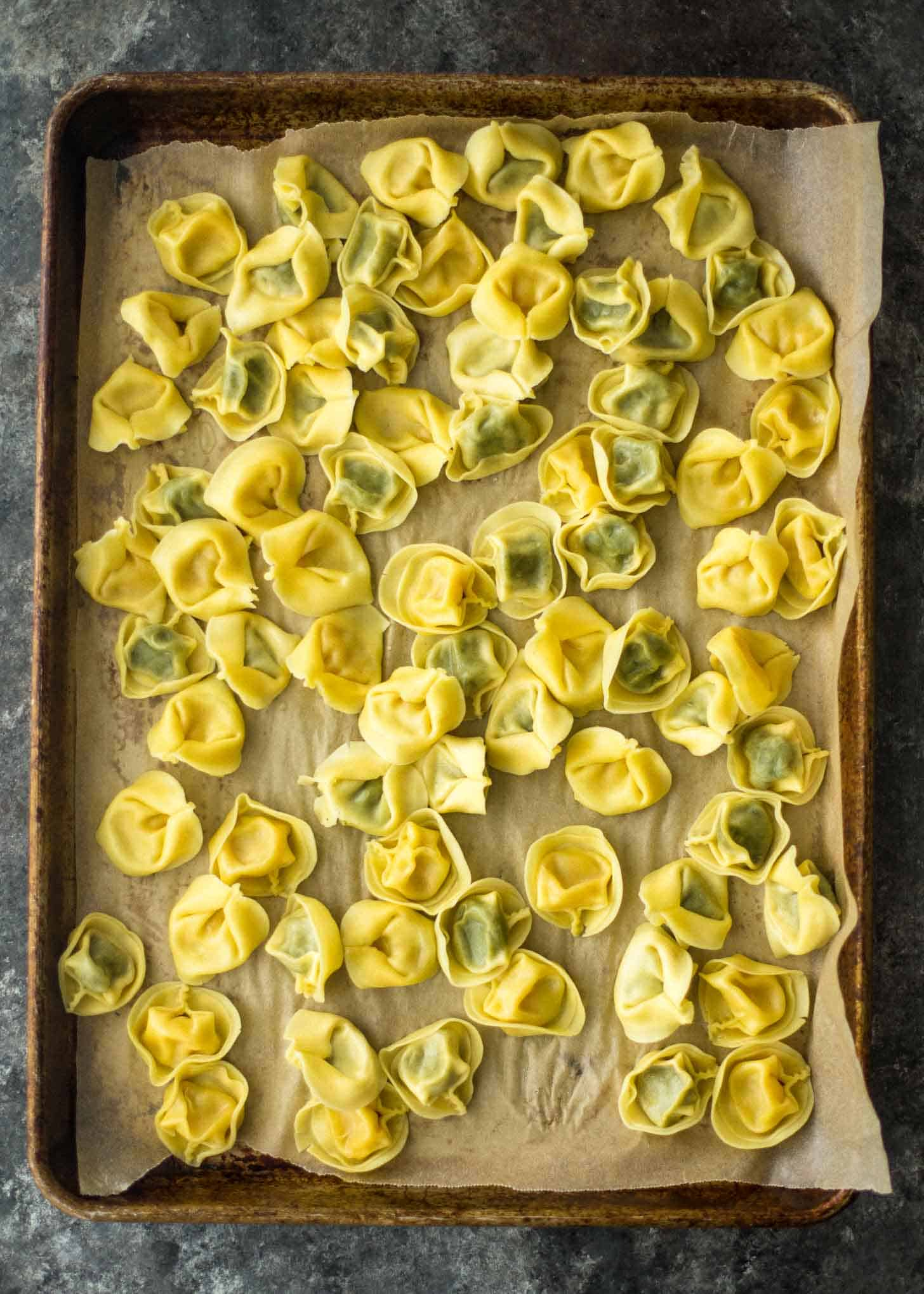cooling tortellini on parchment
