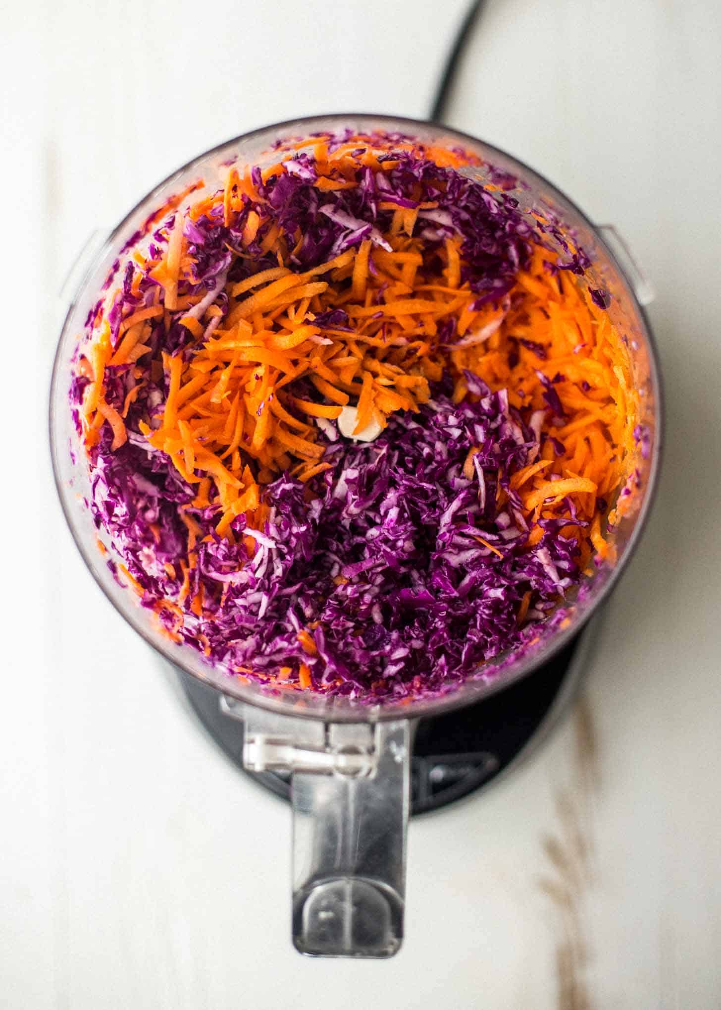 carrots and cabbage in a food processor