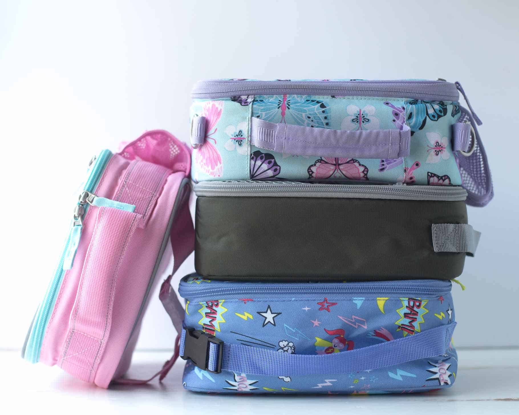 Insulated lunch boxes for kids - L.L. Bean Classic, Packit Freezable Classic, Pottery Barn Fairfax Classic, and Pottery Barn Mackenzie Cold Pack.