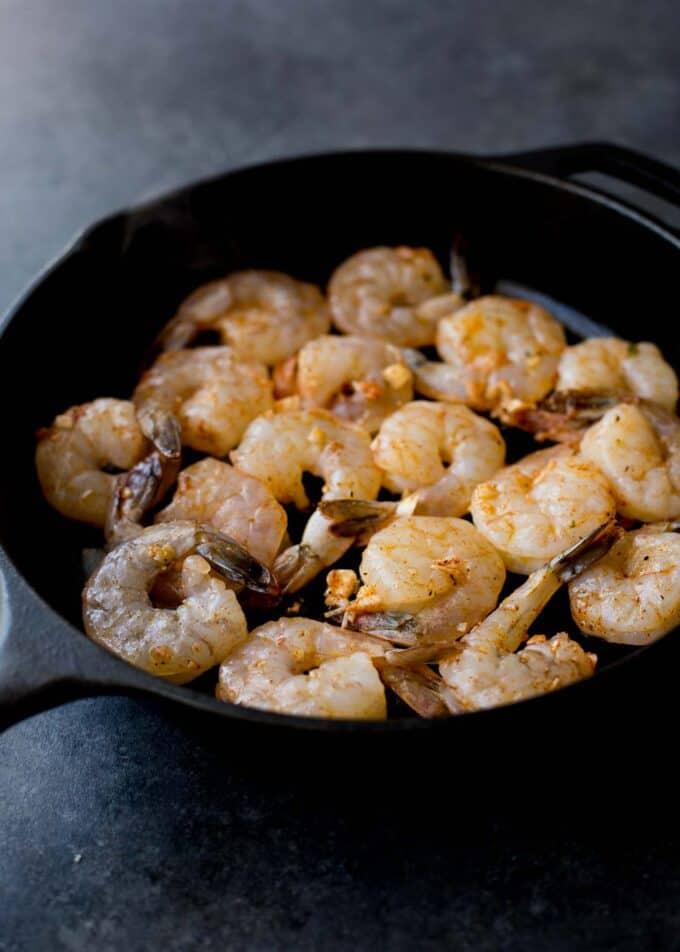 raw shrimp in skillet