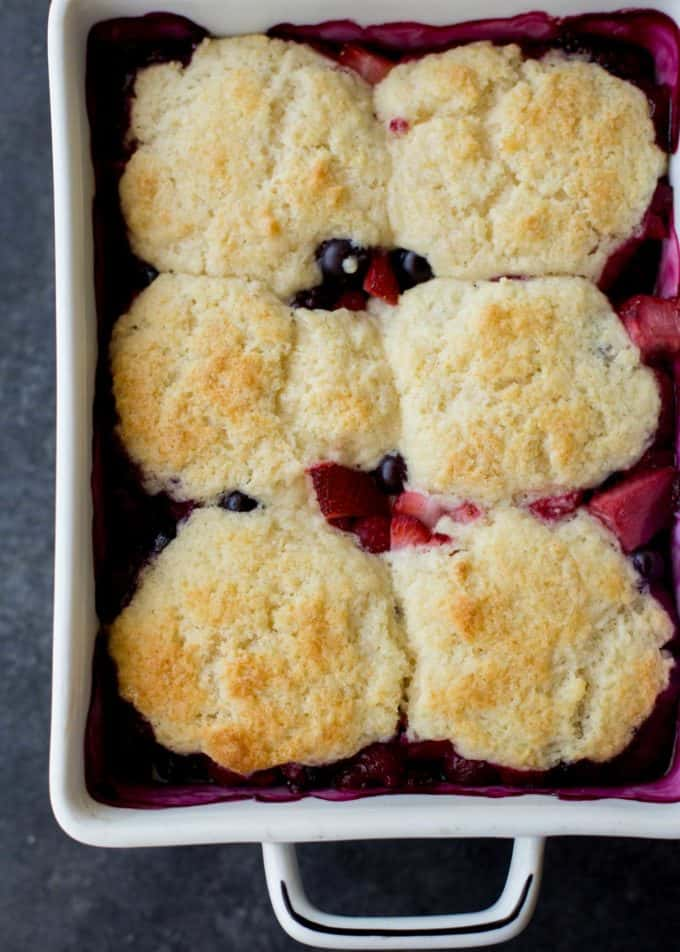 berry cobbler in a white baking dish