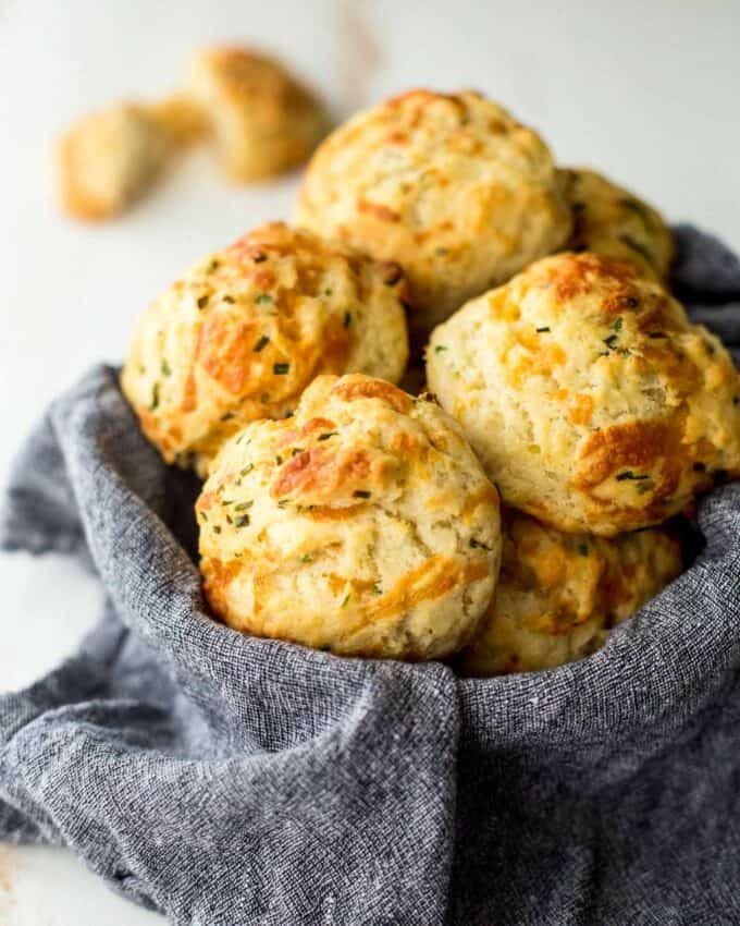 cheddar drop biscuits in a towel lined basket