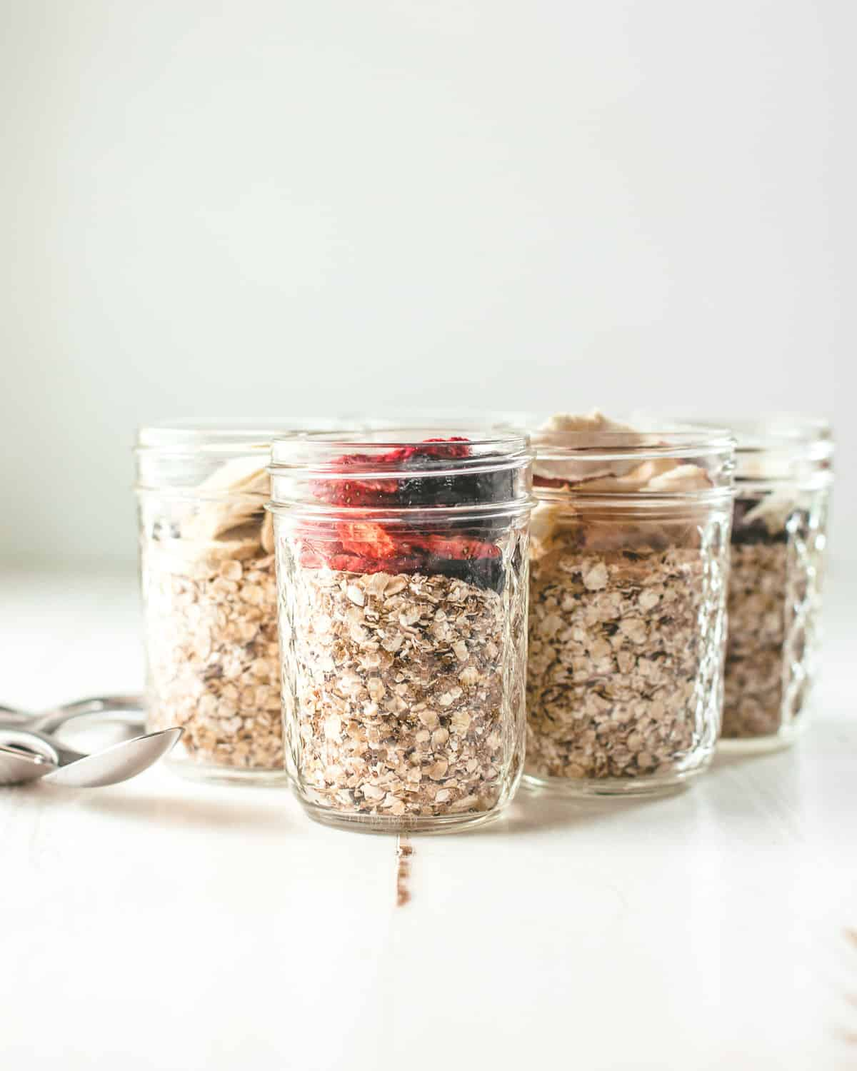 mason jars with homemade oatmeal on a white table