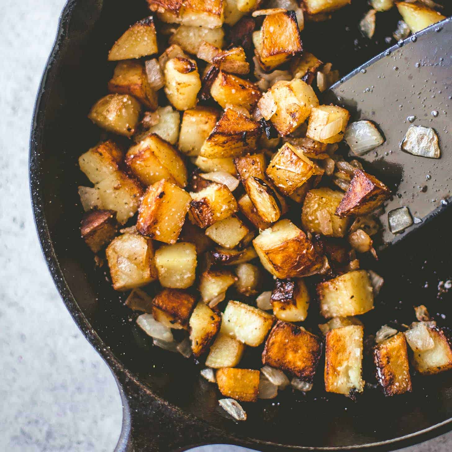 cooking potatoes in a skillet