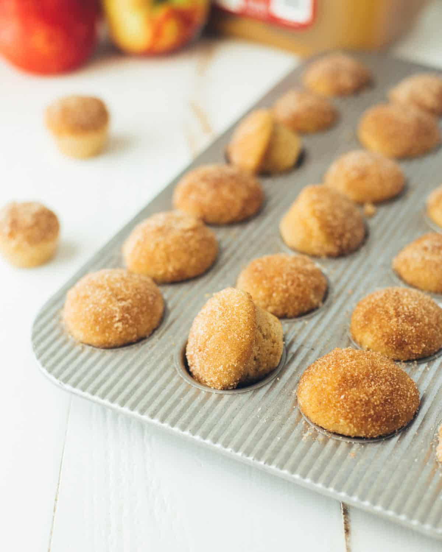 apple cider donut mini muffins in a muffin tin