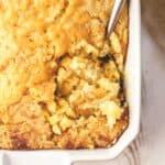 corn casserole in a white baking dish
