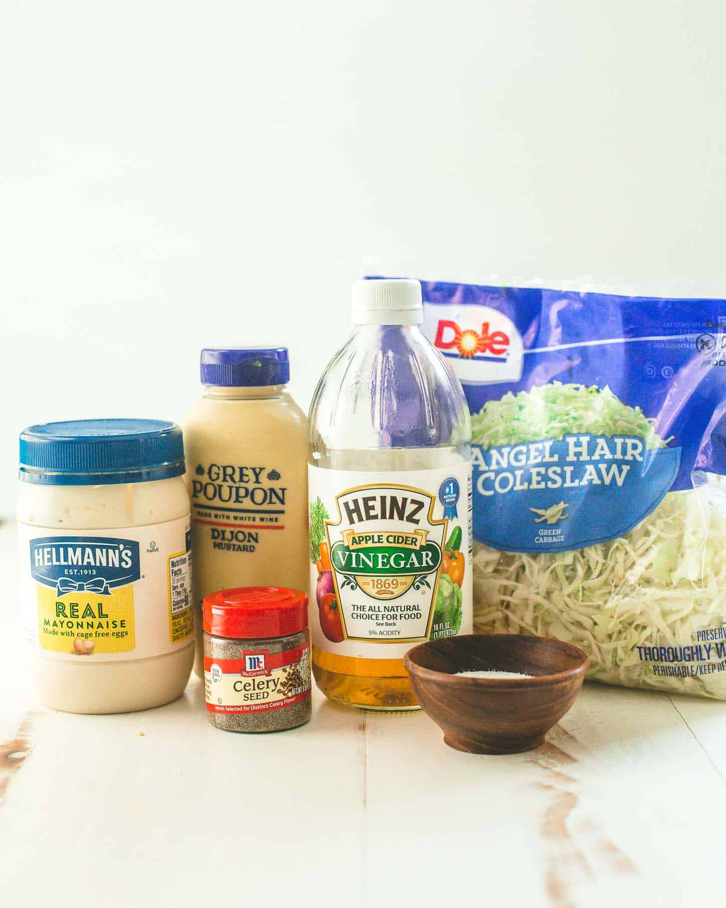 ingredients for coleslaw on a white table