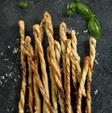 baked breadsticks on a grey countertop