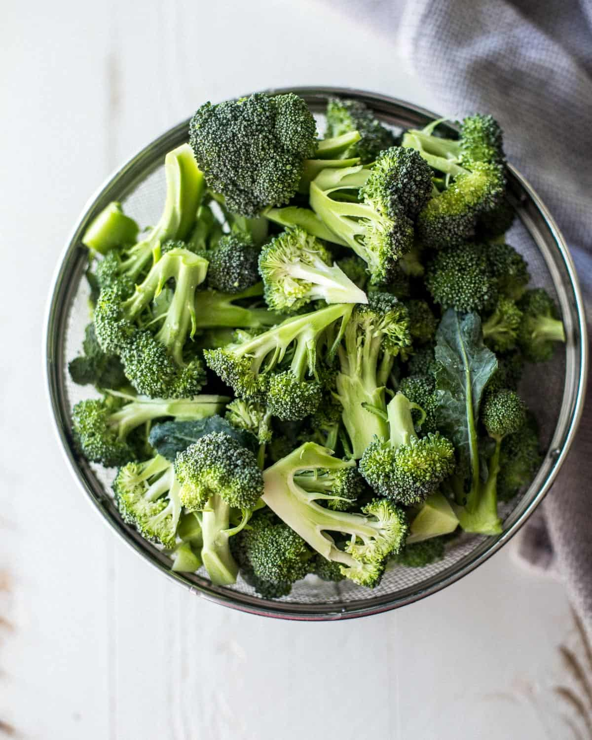 raw broccoli in a clear bowl