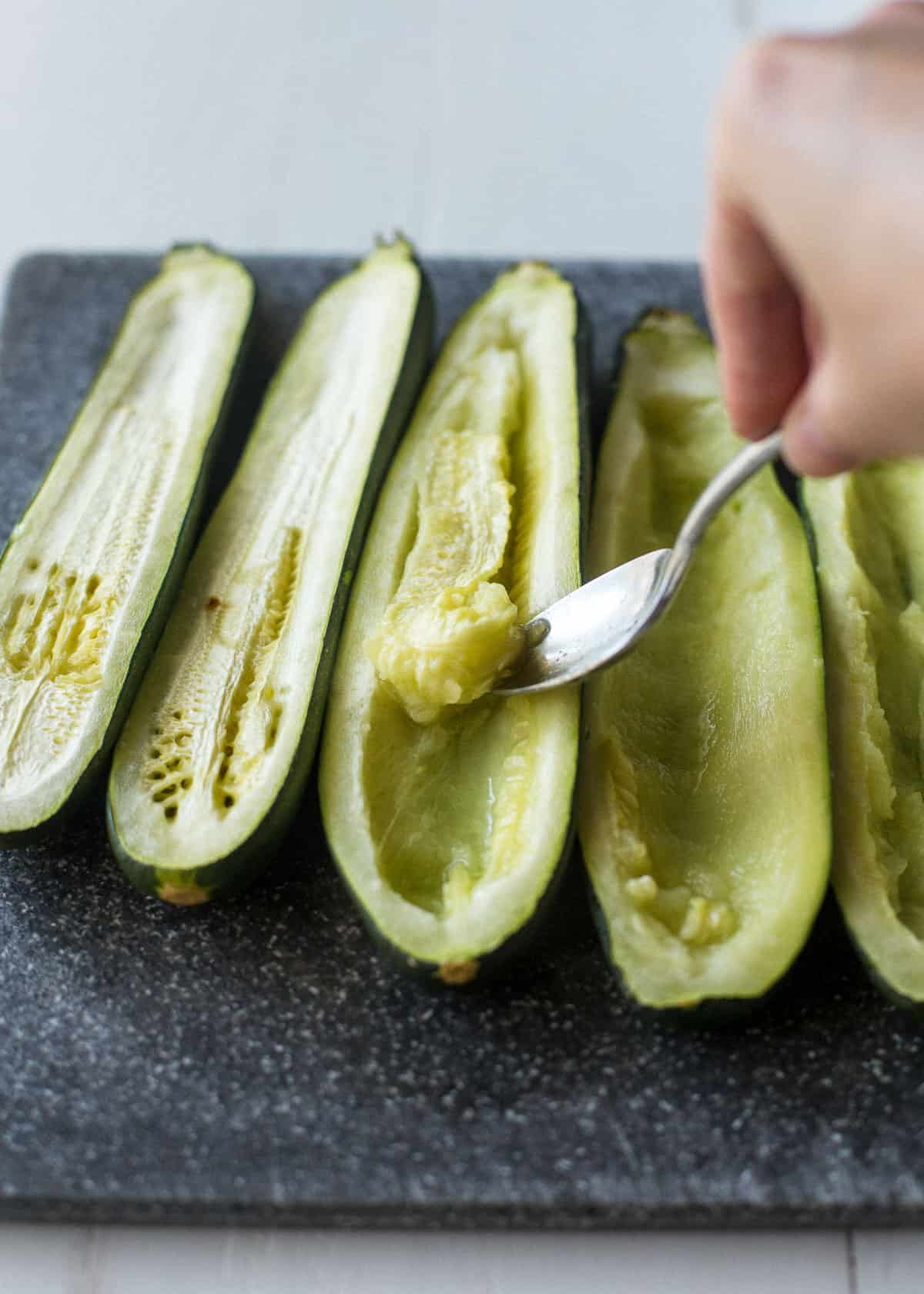 cooked zucchini cut in half