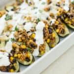 stuffed zucchini in a white baking dish