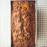 banana bread in a pan with chocolate chips