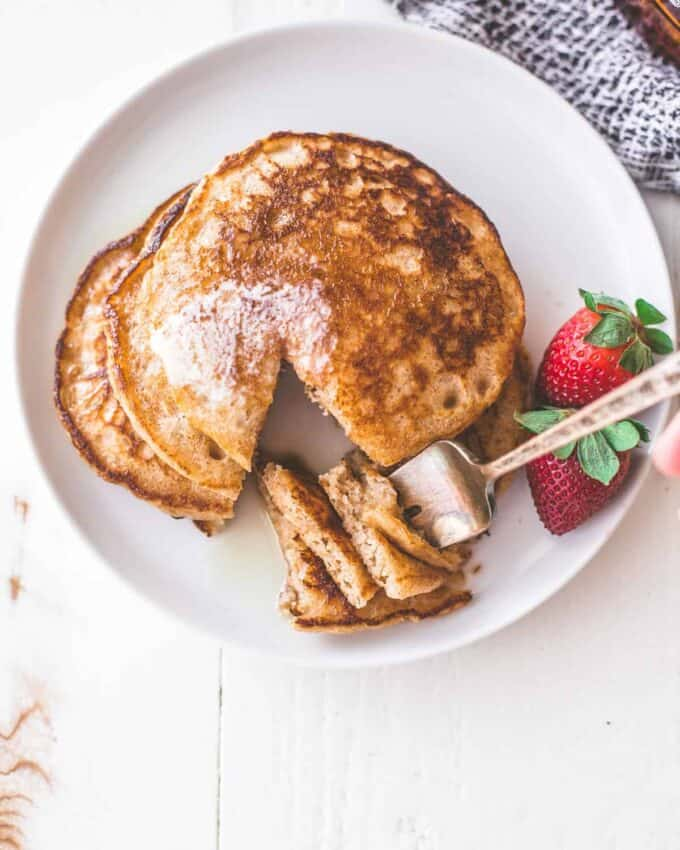 whole wheat pancakes on a white plate