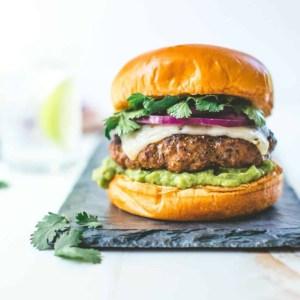tex mex burger on a grey tray