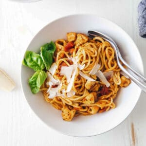 chicken spaghetti in a bowl with utensils