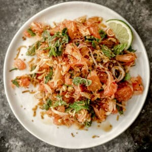 thai pomelo salad on a plate with lime