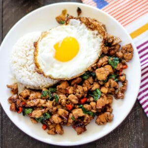 pad grapow with an egg and rice on a plate