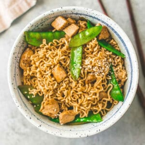 sesame ramen noodle stir fry in bowl on table