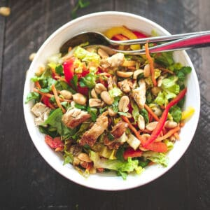 thai chopped salad in a bowl with utensils