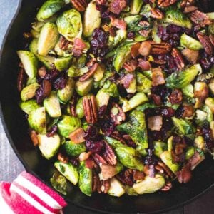 balsamic brussels sprouts with nuts and berries in a skillet