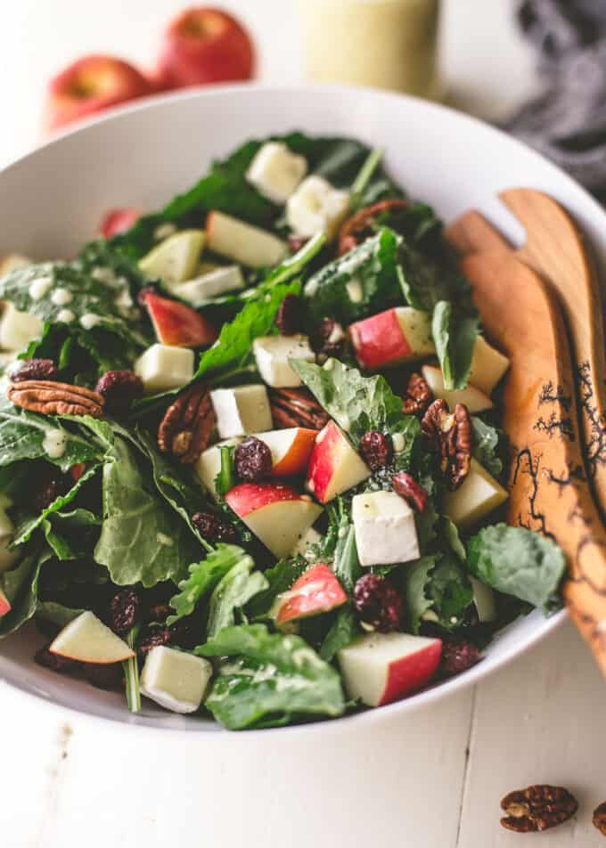 apple, brie and pecan salad in a white bowl