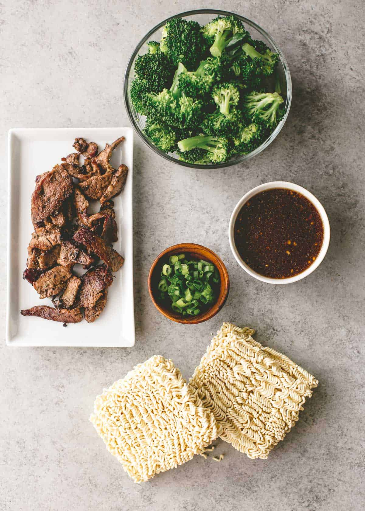 ingredients for beef and broccoli stir fry on a grey counter