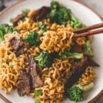 eating ramen stir fry with chopsticks