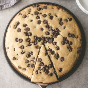 chocolate chip ricotta cake in a round baking pan