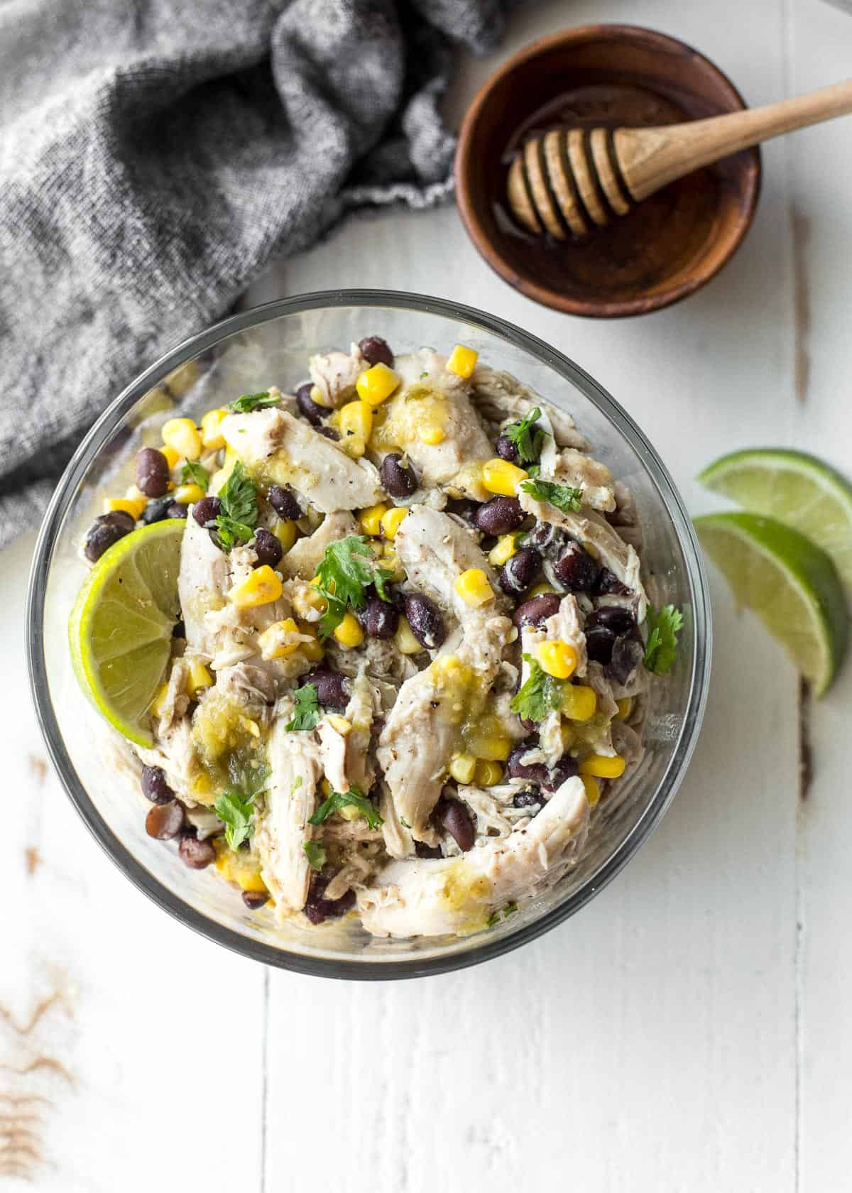 green salsa chicken in a clear bowl