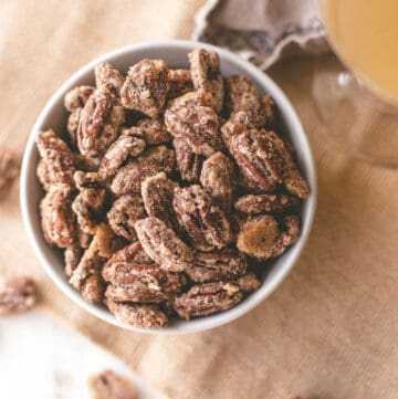 sweet and spicy candied pecans in a white bowl