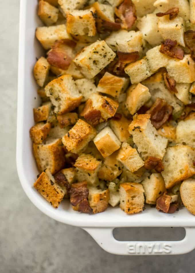 cooked stuffing in a white baking dish