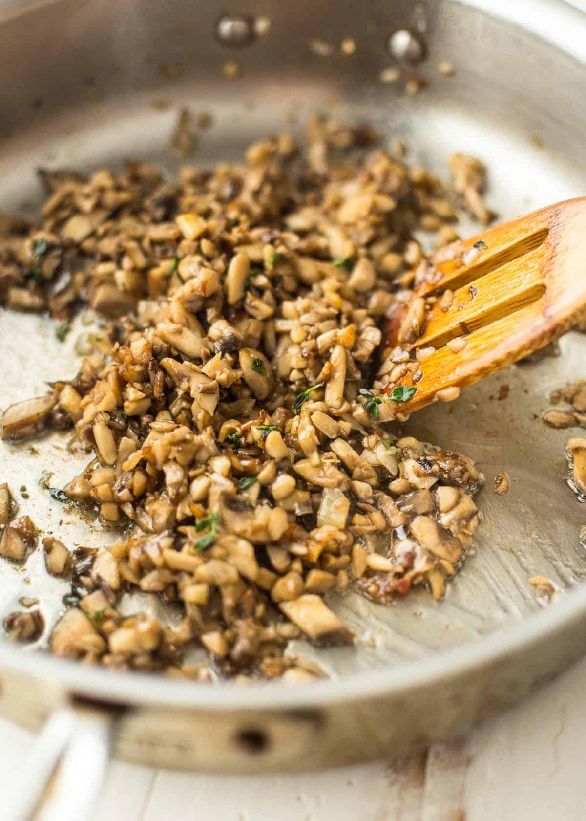 sautéing mushrooms in a pan