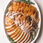 sliced turkey on a white tray