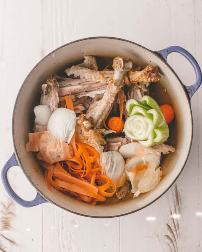 turkey bones and vegetables in a dutch oven