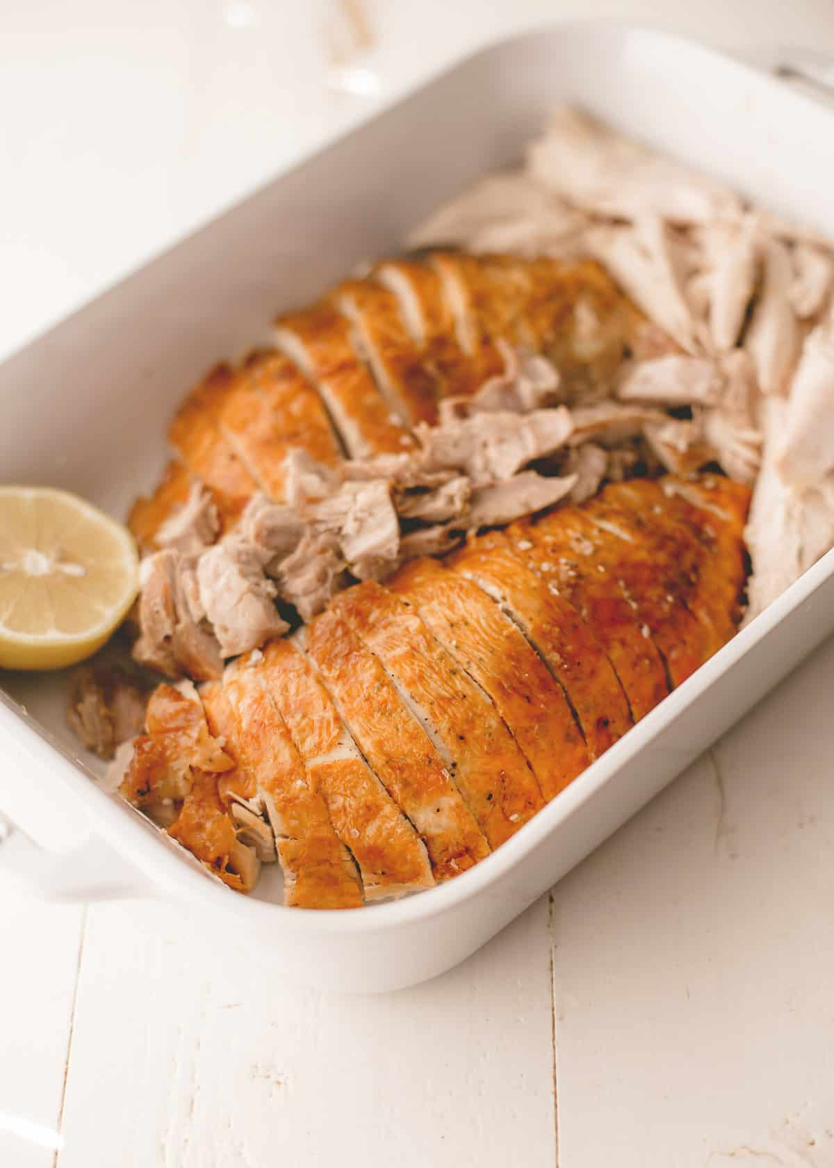 sliced roasted turkey in a baking dish