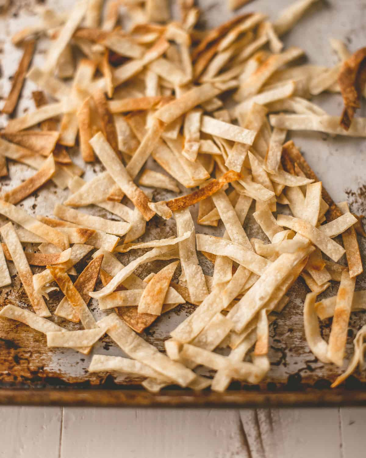 tortilla strips on a sheet pan