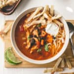 turkey tortilla soup topped with sour cream and cheese