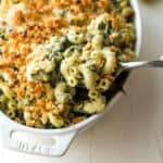 spinach and artichoke baked pasta in a white baking dish