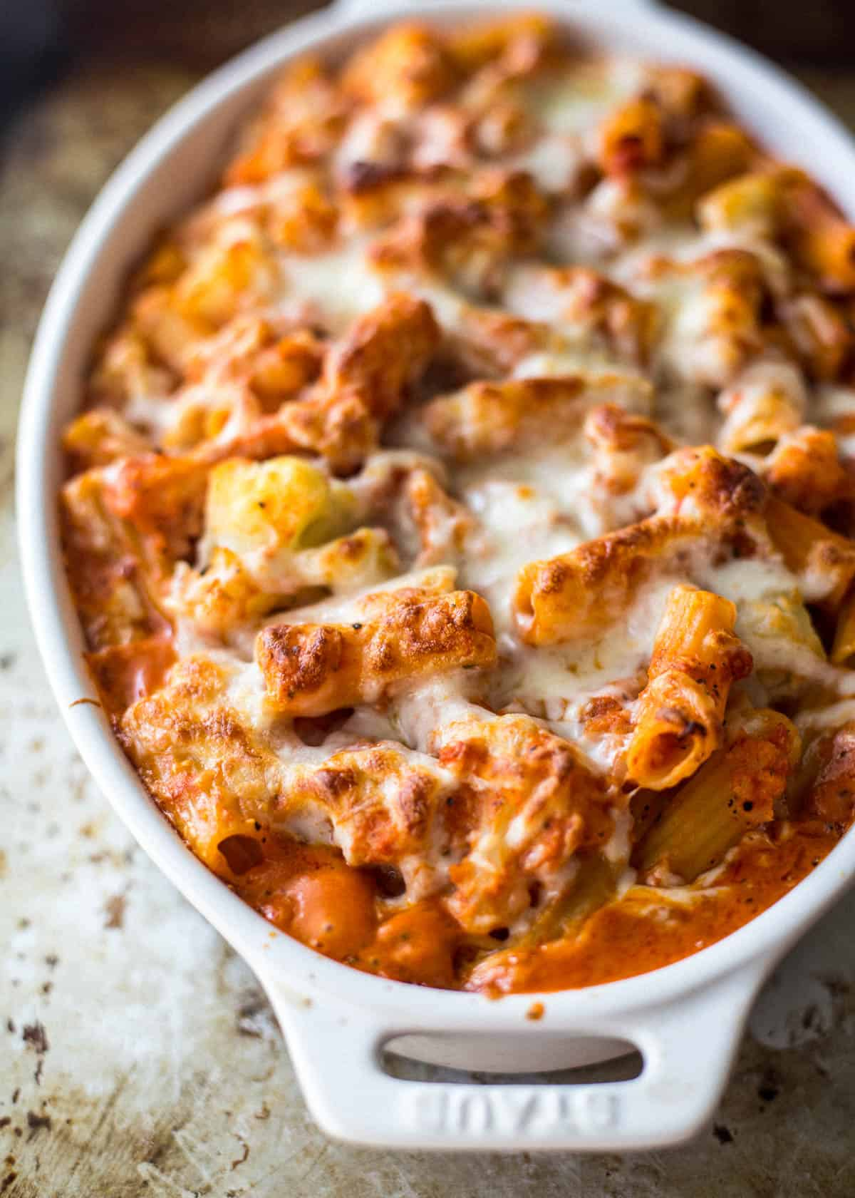 baked ziti in a white oval baking dish