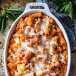 cauliflower baked ziti in a white oval baking dish