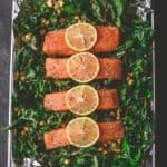 salmon on a bed of greens