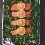 salmon filets on a bed of greens and chickpeas